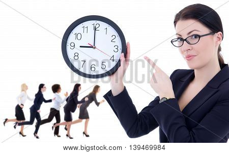 deadline concept - young woman holding office clock and her running colleagues isolated on white background
