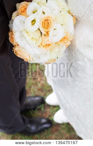 Wedding bouquet of flowers in orange, and white