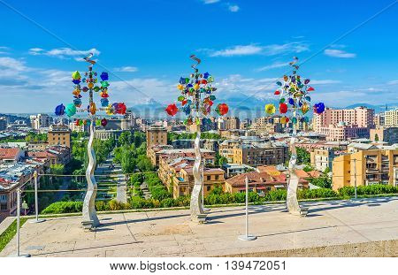 YEREVAN ARMENIA - MAY 29 2016: The weathervane trees made of metal with glass flowers located on the fouth level of Cascade on May 29 in Yerevan.