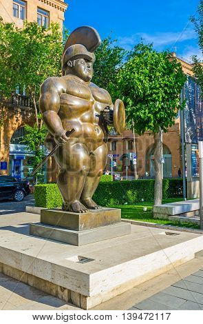 YEREVAN ARMENIA - MAY 29 2016: The Roman Warrior by F Botero is represented by Cafesjian Center for Art in sculpture garden in Tamanyan street on May 29 in Yerevan.