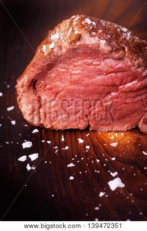grilled scotch steak on wood with salt