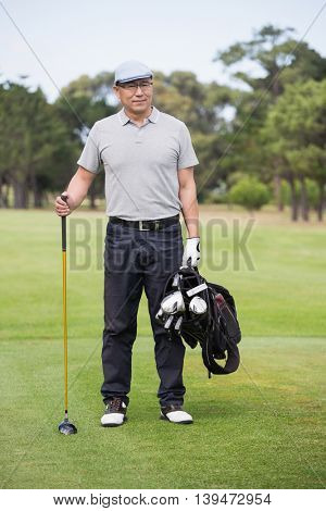 Portrait of golfer standing on field