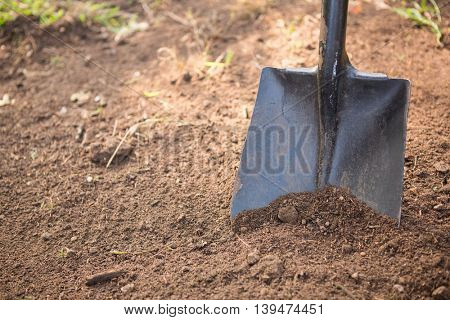 High angle view of shovel on dirt at community garden