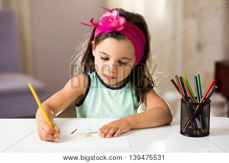 Little Girl Is Drawing Pictures With Pleasure