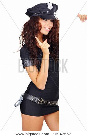 sexy girl in police uniform with handcuffs and white board for text