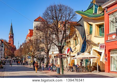 SOPOT, POLAND - APRIL 15, 2016: Some people on Monte Cassino street with many shops, clubs, galleries. Sopot is a very popular tourist resort in the country.
