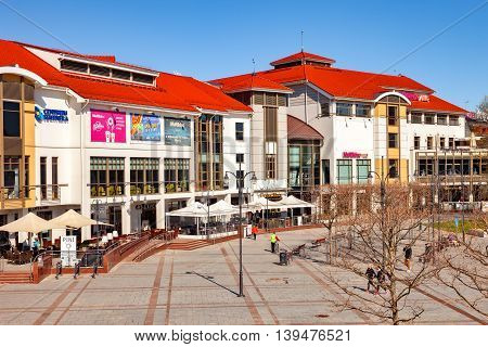 SOPOT, POLAND - APRIL 15, 2016: Some people on Monte Cassino street, Sopot most famous street with many shops, clubs, galleries. Sopot is a very popular tourist resort in the country.