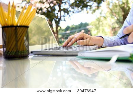 businessman working with a laptop sitting outside
