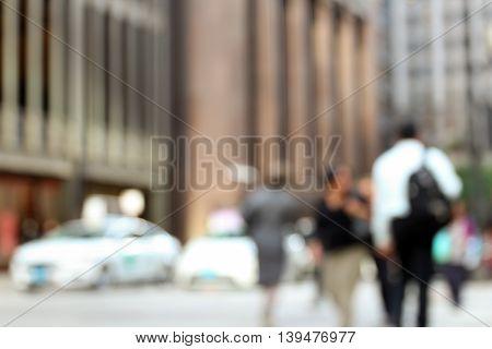 people in bokeh street of downtown. Urban city behind