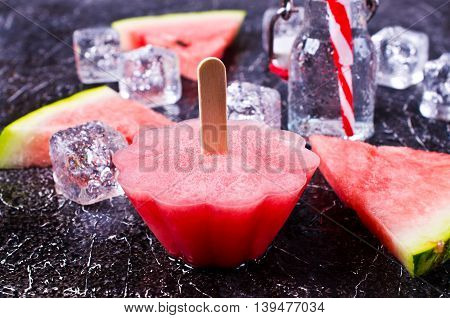 Homemade sorbet of watermelon on a dark background. Selective focus.