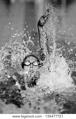 Backstroke swimming, black and white , vertical image