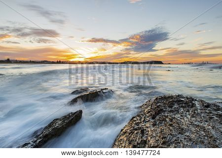 High tide flowing over the rocks during sunset at Currumbin Rock Gold Coast