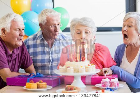 Seniors celebrating a birthday in a retirement home
