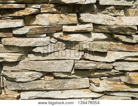 New stone wall closeup in sunny day