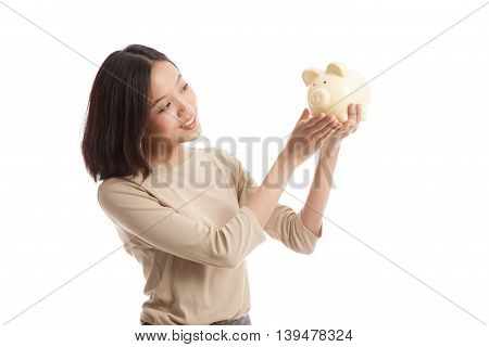 Young Asian Business Woman With A Pig Coin Bank