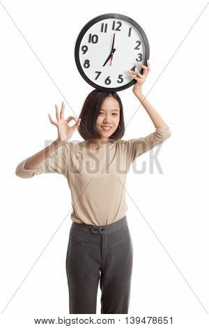 Young Asian Business Woman Show Ok With A Clock