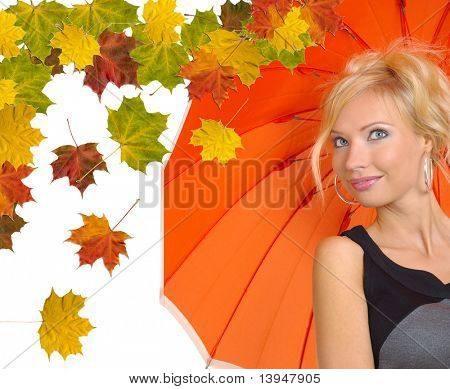 Beautiful woman with orange umbrella over abstract autumn background