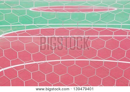 close up white goal net and ground futball