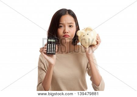 Unhappy Asian Business Woman With Calculator And Piggy Bank