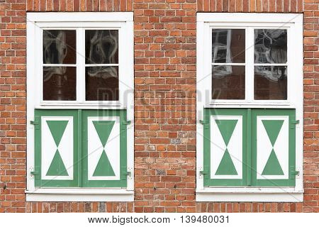 Window of an old brick house, dutch style