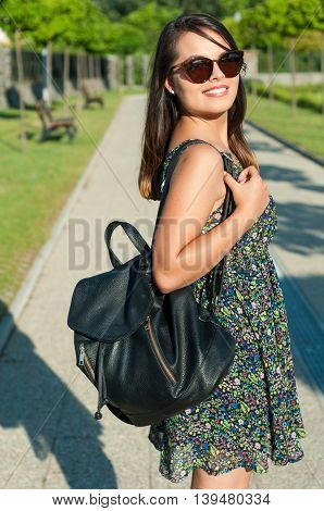 Pretty Lady Smiling Wearing Summer Dress And Backpack