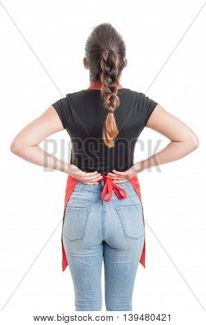 Rear View Of Seller Suffering From Back Pain