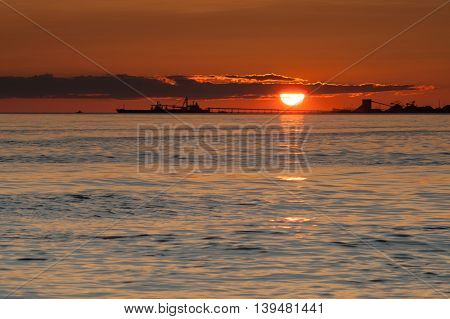 ship silhouette at sunset on Pacific ocean at Point Roberts Washington USA