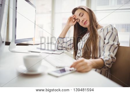 Young businesswoman relaxing in creative office