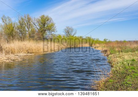 Spring landscape with small Ukrainian river Sura