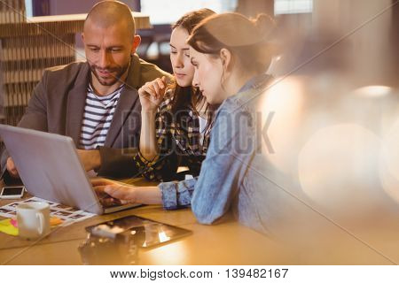 Team of graphic designer working on laptop in the office