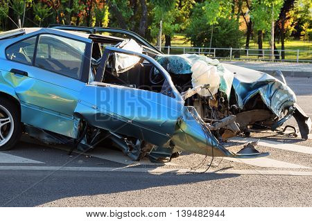 Blue car destroyed after horrible car accident