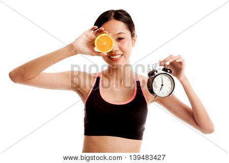 Beautiful Asian Healthy Girl With Orange And Clock