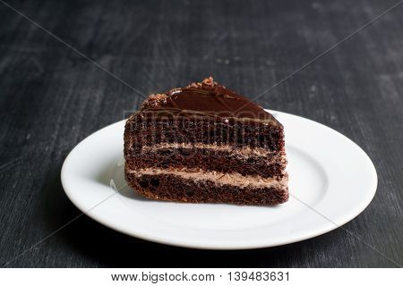 piece of chocolate cake on a dark background