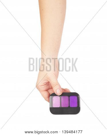 Professional make-up cosmetic in female hand beautician isolated on white background