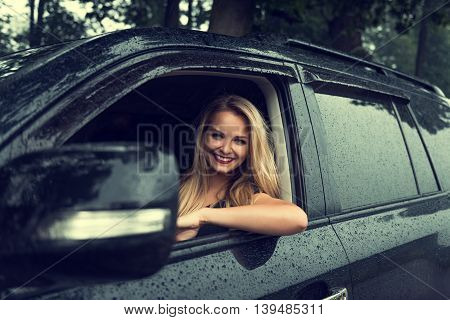 Portrait of a beautiful young woman driving a car