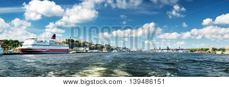 View to Stockholm, Sweden with a ferry from sea in summer
