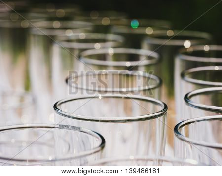 Row of glasses macro shot. Empty glasses on a banquet table close up