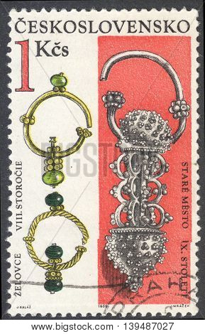 MOSCOW RUSSIA - CIRCA FEBRUARY 2016: a post stamp printed in CZECHOSLOVAKIA shows gold earrings (the 8th-9th Century) the series