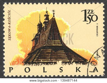 MOSCOW RUSSIA - CIRCA FEBRUARY 2016: a post stamp printed in POLAND shows a traditional Polish building the series