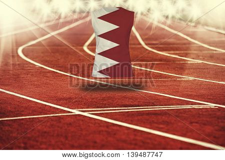 Red Running Track With Lines And Bahrain Flag On Shirt