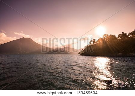 Landscape of San Pedro volcano and Lake Atitlan seen on sunset Guatemala