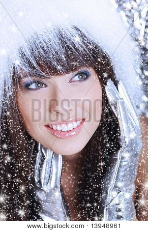 Winter Girl with beautiful make up, silver gloves and snow flake, silver background