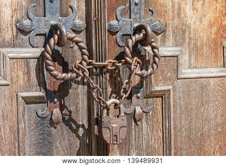 Lock and chain on an old door. Vintage