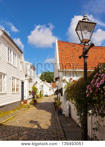 View to the traditional Norwegian white wooden houses in Stavanger Norway.