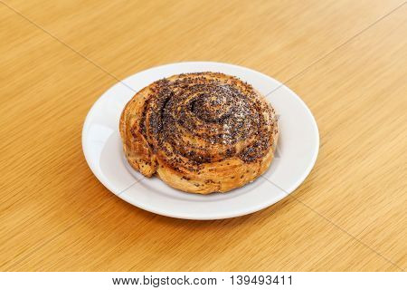 Sweet Roll Bun With Poppy On Table