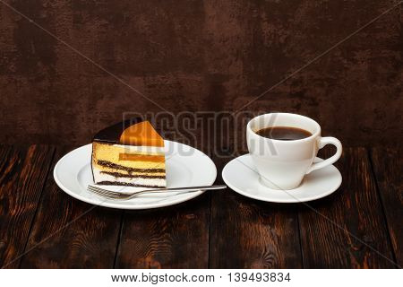 Orange Cake Slice And Coffee Cup On Wooden Background