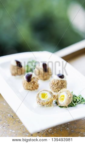 breaded pork and quail egg gourmet sophisticated modern cuisine starter snack food