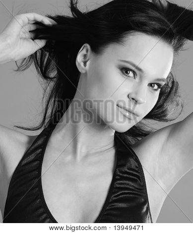 Black & White portrait beautiful, sexy, sad expression young brunette woman. In the studio.