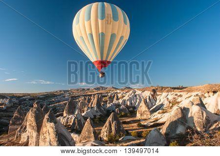 Balloon over a mountain valley in Cappadocia autumn