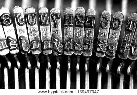 Typing. Metal types in the old typewriter